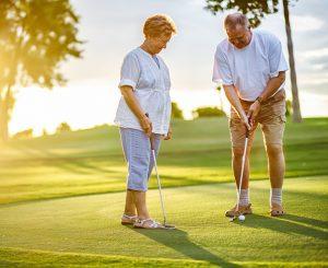 older couple golfing thinking about medicare